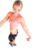 A pretty young woman with weight management measuring tape Royalty Free Stock Images