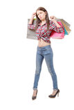 Pretty young woman went shopping on white background Stock Photography