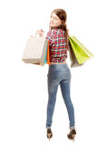 Pretty young woman went shopping on white background Royalty Free Stock Images
