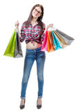 Pretty young woman went shopping on white background Royalty Free Stock Photo