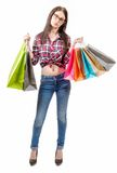Pretty young woman went shopping on white background Stock Photo
