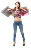 Pretty young woman went shopping on white background Royalty Free Stock Photography
