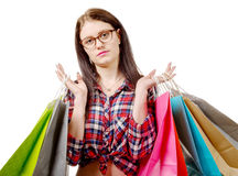 Pretty young woman went shopping on white background Royalty Free Stock Image