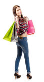 Pretty young woman went shopping on white background. A pretty young woman went shopping on white background Stock Photo