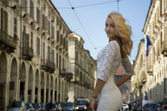 Pretty Young Woman in White Dress at the City Stock Photo