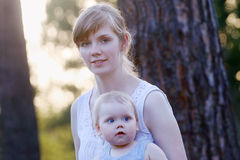 Pretty young woman in white and her little cute daughter Royalty Free Stock Image