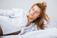 Pretty young woman in a white men`s shirt Royalty Free Stock Photos