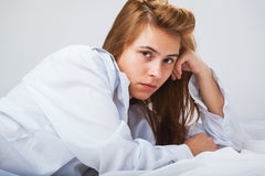 Pretty young woman in a white men& x27;s shirt Stock Image