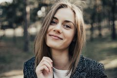 Woman with wide open mouth and raising eyebrow looking at camera Royalty Free Stock Images