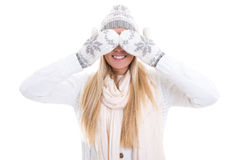 Pretty young woman in winter clothes hiding her face Royalty Free Stock Image