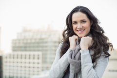 Pretty young woman in winter clothes posing Stock Images