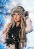 Pretty young woman in a winter fashion shoot Stock Images