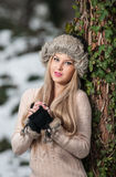 Pretty young woman in a winter fashion shoot Stock Photos