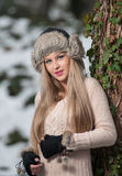 Pretty young woman in a winter fashion shoot Royalty Free Stock Photography