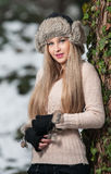 Pretty young woman in a winter fashion shoot Royalty Free Stock Photo