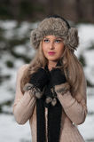 Pretty young woman in a winter fashion shot Royalty Free Stock Photos