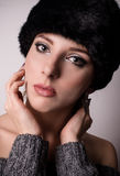 Pretty young woman in a winter fur hat Stock Image