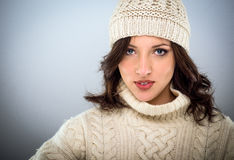 Pretty young woman in winter woollens Royalty Free Stock Images