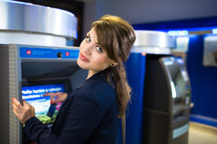 Pretty, young woman withdrawing money from her credit card Stock Photos