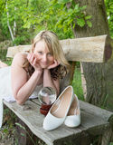 Pretty young woman on a wooden bench Stock Photo