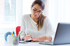 Pretty young woman working in her office. Portrait of pretty young woman working in her office Royalty Free Stock Photo