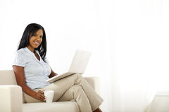 Pretty young woman working on laptop at home Royalty Free Stock Photos