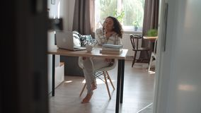 Free Pretty Young Woman Working On Modern Laptop Surrounded By Books At Home. Royalty Free Stock Photo - 133130585