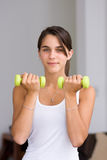 Pretty young woman working out Royalty Free Stock Image
