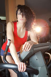 Pretty Young Woman Working Out in a Health Club Stock Photography