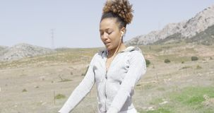 Pretty young woman working out in nature stock video footage