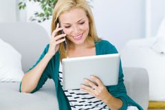 Pretty young woman working and using her mobile phone. Stock Image