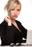 Pretty young woman at workplace Stock Photo