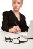 Pretty young woman at workplace Royalty Free Stock Photo