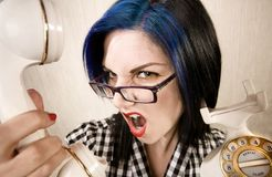 Pretty young woman yelling into a phone Stock Images
