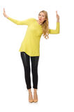 Pretty young woman in yellow blouse Stock Images