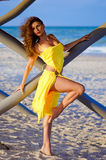 Pretty young woman in a yellow dress Royalty Free Stock Photography