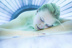 Pretty young womanin a modern solarium Royalty Free Stock Photography