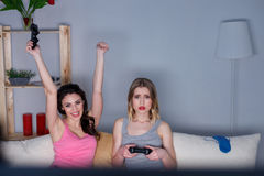 Pretty young women entertaining at home Stock Image
