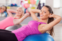 Pretty young women are exercising in fitness Royalty Free Stock Photo