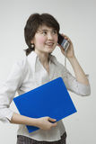 Pretty young women with file. Young pretty women with file and phone Royalty Free Stock Image