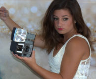 Hollywood Glamour. Young woman with vintage camera with soft focus filter Royalty Free Stock Image