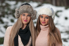 Pretty young women in a winter fashion shot. Attractive young women in a winter fashion shot.Winter wild girls on snow.Winter Girls with beautiful make up, and Stock Photo
