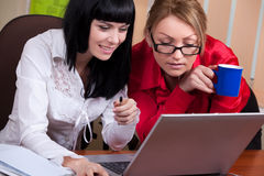 Pretty young women at workplace Royalty Free Stock Images