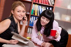 Pretty young women at workplace Royalty Free Stock Photos