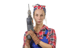 A pretty young worker with a drill Royalty Free Stock Images