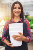 Pretty young worker in a floriculture business Royalty Free Stock Image