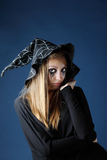 Pretty zombie girl with black tears and cut throat in hat royalty free stock images