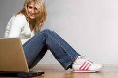 Prettygirl with laptop computer Stock Image