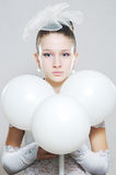 Prettyl teenage girl with white balls Royalty Free Stock Photos