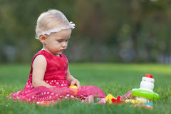 Prettylittle girl is playing with toy pyramid Royalty Free Stock Photos